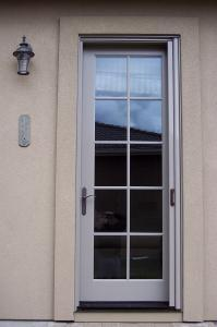 glass entry door with mirage retractable screen installed