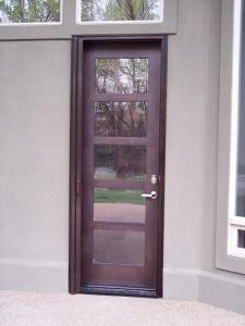 wooden entry door with matching mirage retractable screen door installed