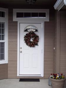white retractable screen door installed on white entry door