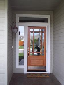 wood & glass single entry door with white retractable screen installed