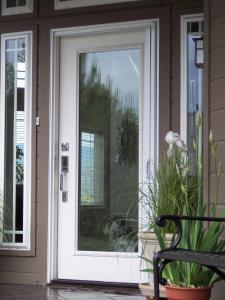 retractable screen door installed on white single entry door