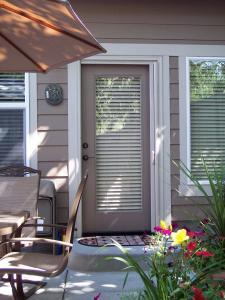 white mirage retractable screen door on beige single entry patio door