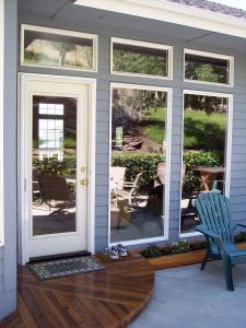 white retractable screen door on single patio door