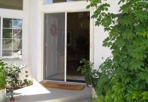 white double entry door with two white mirage retractable screens