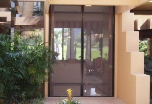 double entry retractable screens door opened up to allow the fresh air inside