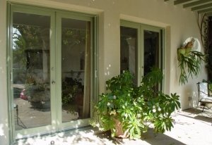 two double entry doors with custom mirage retractable screens installed
