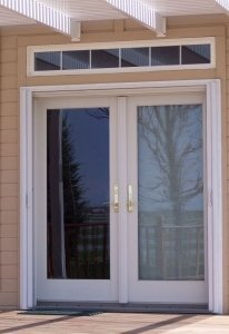 two white double entry doors with retractable screens installed