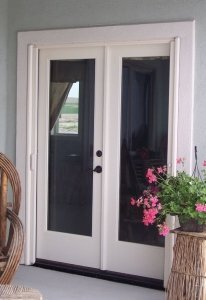 white double entry doors with white mirage retractable screen doors installed