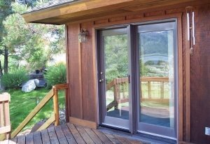 double entry patio doors with gray retractable screens installed