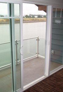 sliding glass door on waterfront home