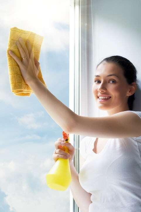 Woman cleaning retractable window screen