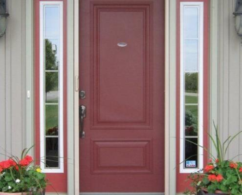 Mirage retractable screen door installed on red entry door