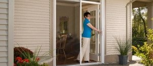 Retractable screen door application on patio door