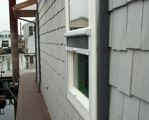 retractable window screen installed on floating home