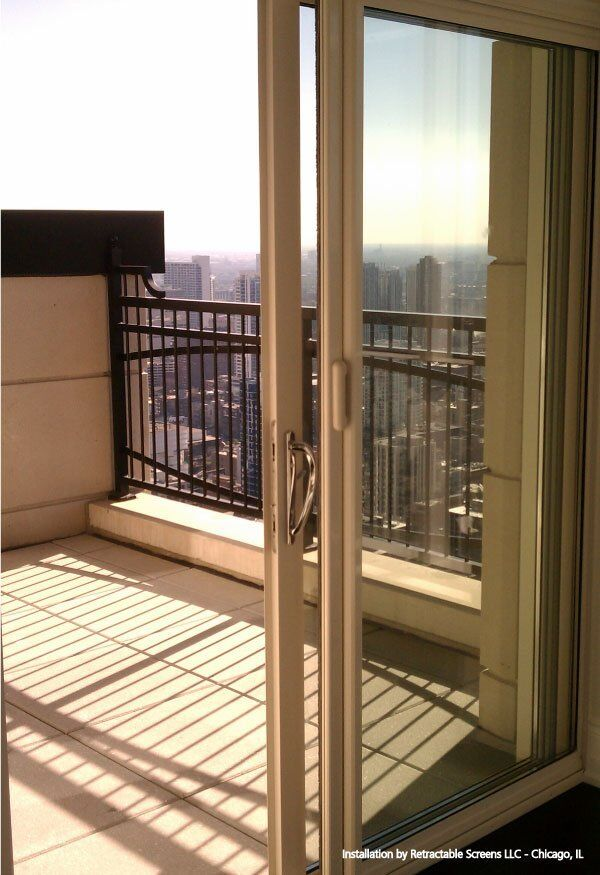 Sliding condo door with retractable screen door installed