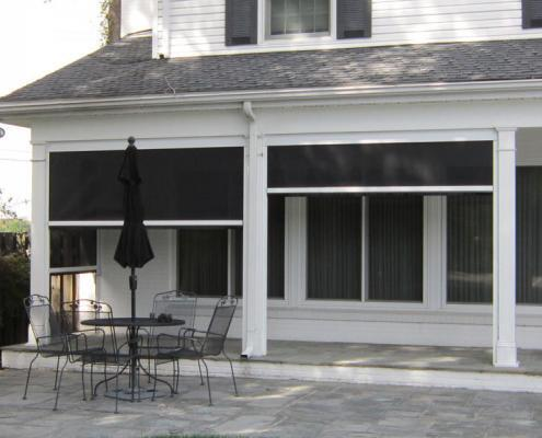Colonial Style Porch with Motorized Retractable Screens Installed