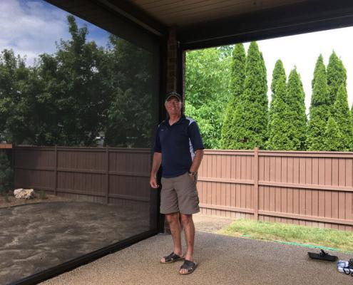 Motorized Retractable Screen Application on patio with owner